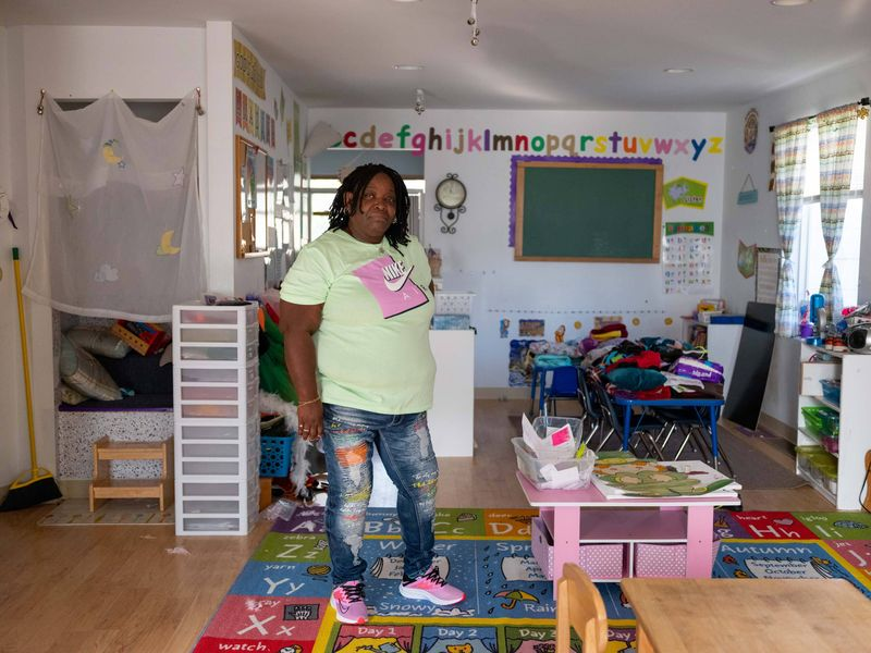 Jackie Thomas standing in the interior of one of her daycare centers.